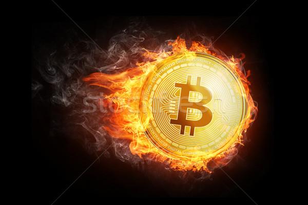 Golden bitcoin coin flying in fire flame. Stock photo © RAStudio