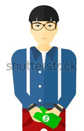 Férfi megbilincselve bűnözés üzletember bilincs pénz Stock fotó © RAStudio