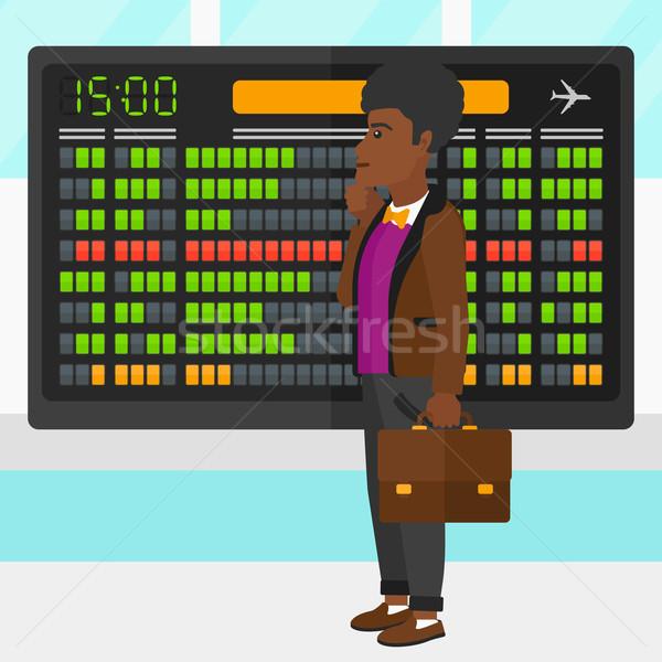 Homem olhando programar conselho aeroporto vetor Foto stock © RAStudio