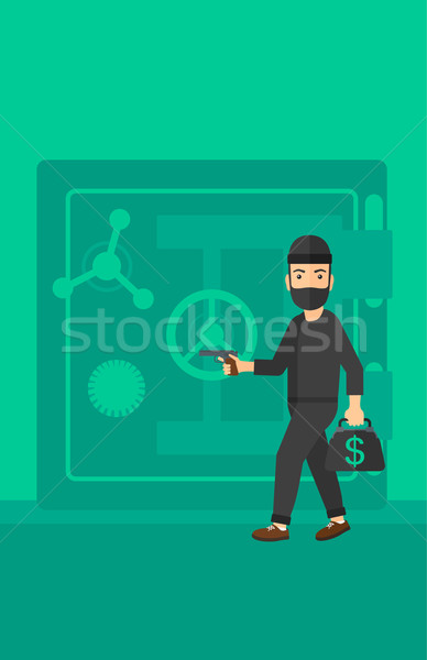 Robber with gun near safe. Stock photo © RAStudio