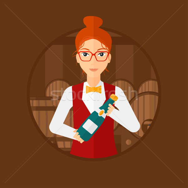 Waitress holding bottle in wine cellar. Stock photo © RAStudio