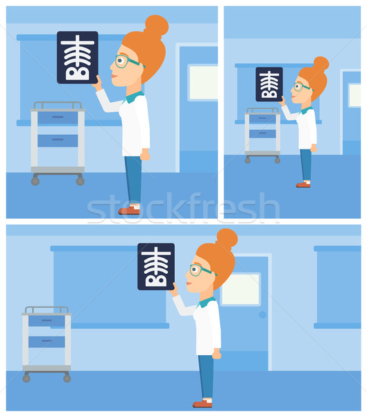Stock photo: Doctor examining radiograph.
