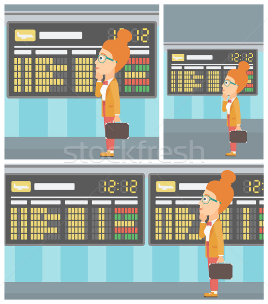 Woman looking at schedule board in the airport. Stock photo © RAStudio