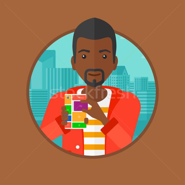 Man with modular phone vector illustration. Stock photo © RAStudio