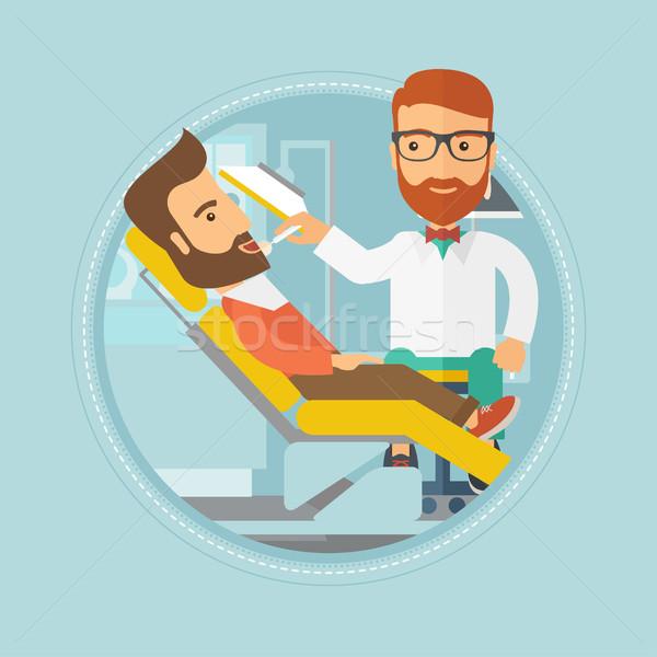Pacjenta recepcji dentysta człowiek posiedzenia Zdjęcia stock © RAStudio