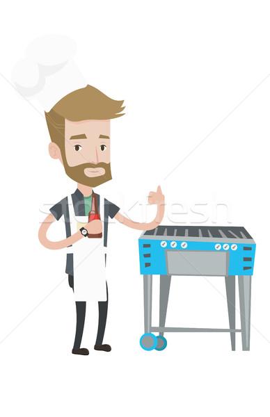 Adam pişirme et gaz barbekü şişe Stok fotoğraf © RAStudio
