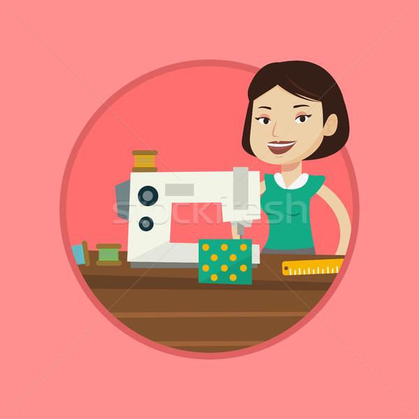 Seamstress using sewing machine at workshop. Stock photo © RAStudio