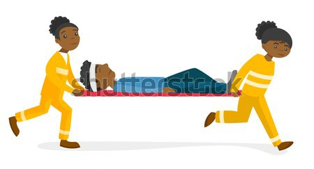 Emergency doctors carrying woman on stretcher. Stock photo © RAStudio