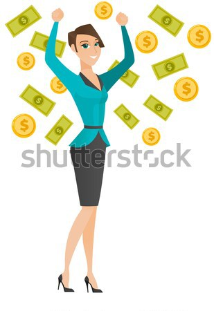 Happy busiess woman under money rain. Stock photo © RAStudio