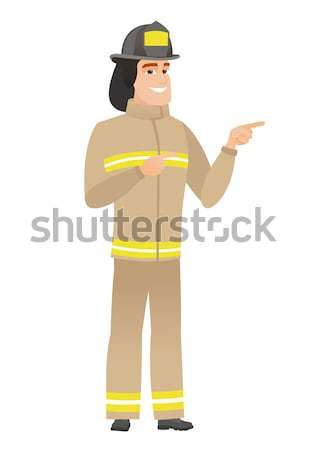 Young caucasian firefighter laughing out loud. Stock photo © RAStudio