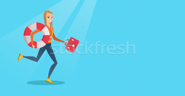 Paramedic running with first aid box. Stock photo © RAStudio