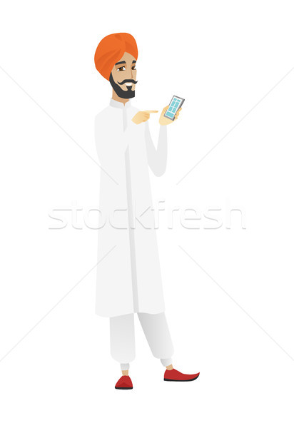 Hindu businessman holding a mobile phone. Stock photo © RAStudio