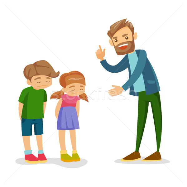 Angry Caucasian white father scolding his children Stock photo © RAStudio