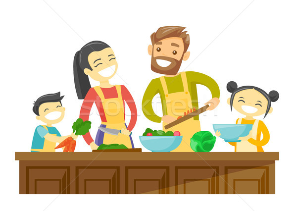 Multiracial family with kids cooking together. Stock photo © RAStudio