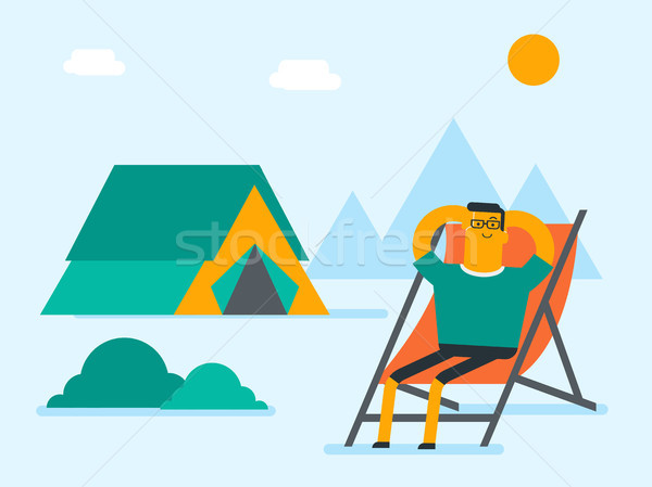 Man sitting in a folding chair in the camping. Stock photo © RAStudio