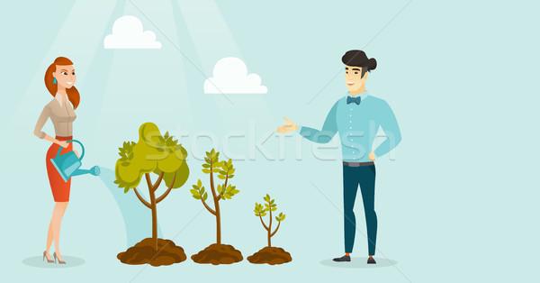 Business people watering trees of three sizes. Stock photo © RAStudio
