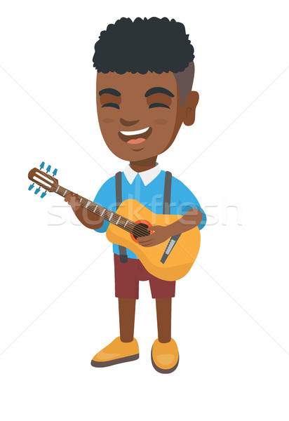 African boy singing and playing acoustic guitar. Stock photo © RAStudio