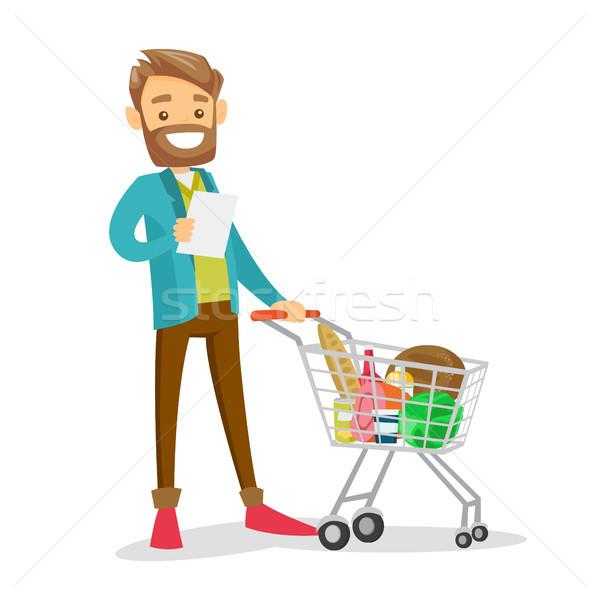 Fiatal kaukázusi fehér férfi vásárlás lista áll Stock fotó © RAStudio