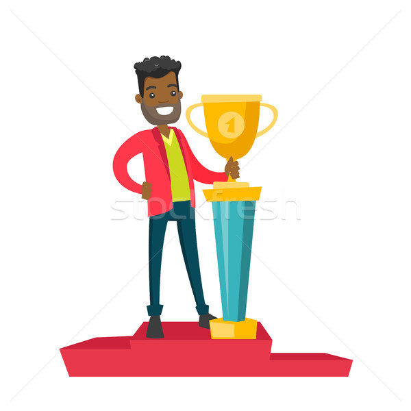 Man standing on the pedestal with business award. Stock photo © RAStudio