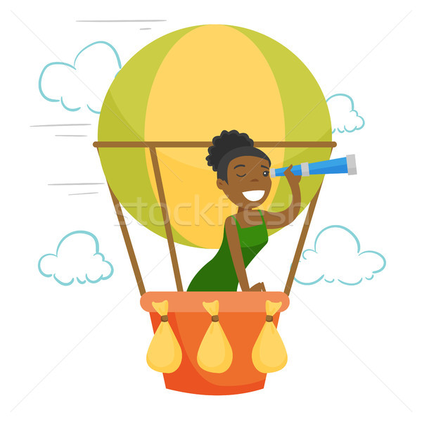 African-american woman flying in hot air balloon. Stock photo © RAStudio