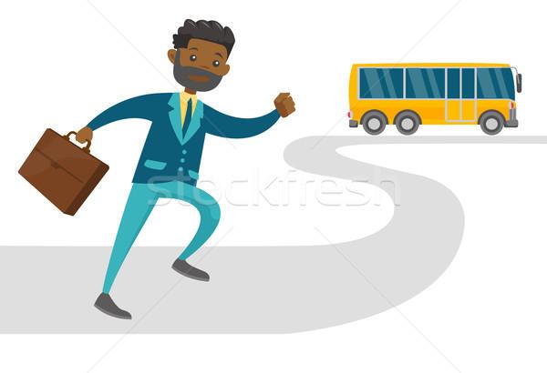 Black latecomer man running for the bus. Stock photo © RAStudio