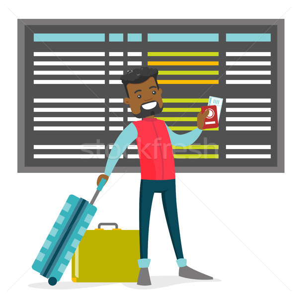 A black man with a passport and luggage in the airport. Stock photo © RAStudio