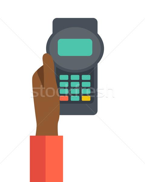 Holding credit card machine Stock photo © RAStudio