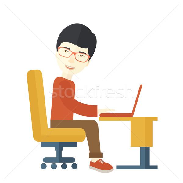 Японский парень сидят компьютер глядя работу Сток-фото © RAStudio
