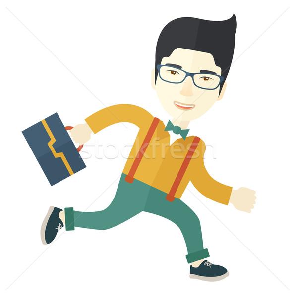 Japanese Worker with briefcase is running. Stock photo © RAStudio