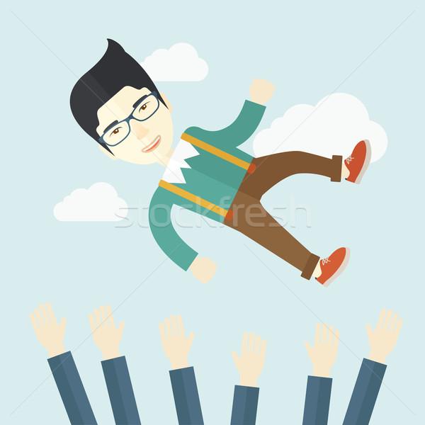 Agresszív japán üzletember dob felfelé égbolt Stock fotó © RAStudio