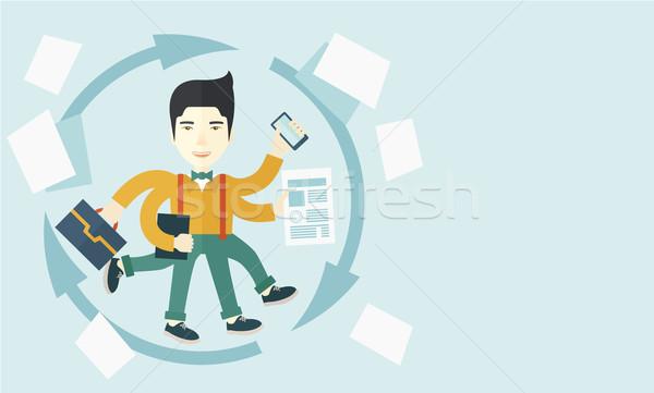 Chinese man with multitasking job Stock photo © RAStudio