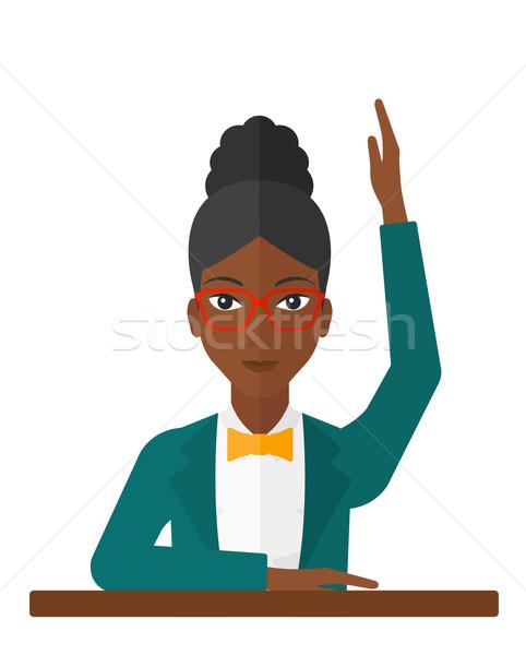 Woman raising her hand. Stock photo © RAStudio