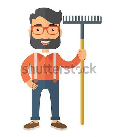 Farmer with rake. Stock photo © RAStudio