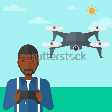 Man flying drone. Stock photo © RAStudio