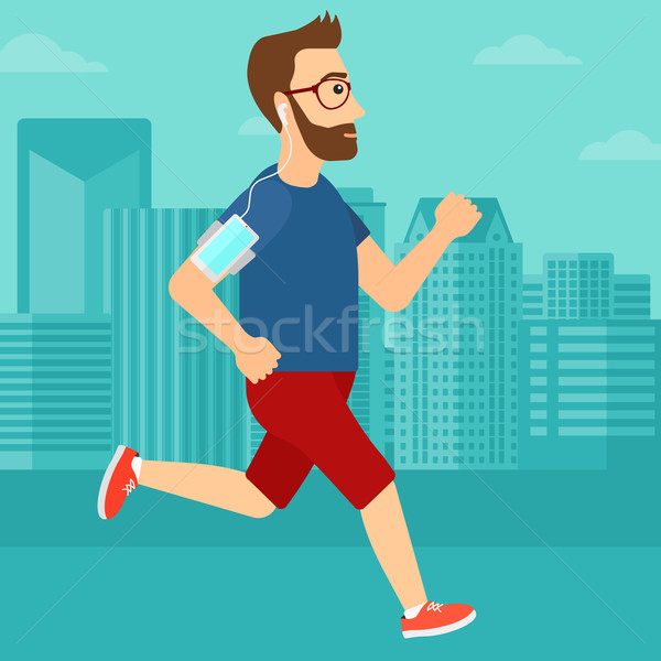 Man jogging with earphones and smartphone. Stock photo © RAStudio