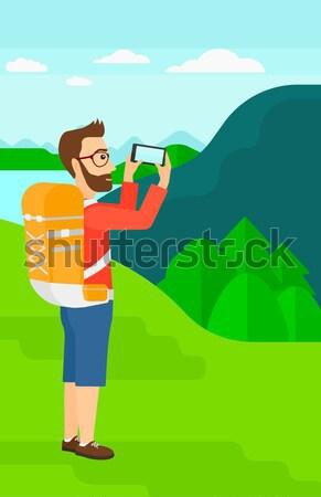 Zaino in spalla guardando mappa asian uomo fotocamera Foto d'archivio © RAStudio