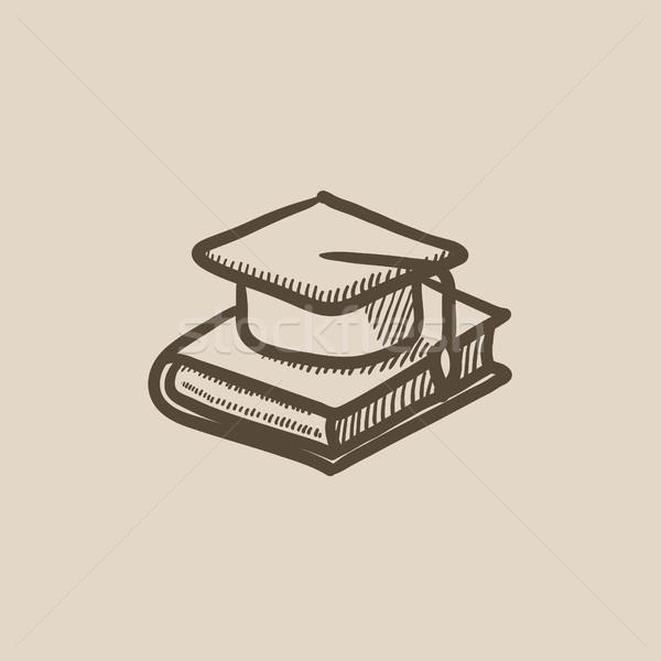 Graduation cap laying on book sketch icon. Stock photo © RAStudio