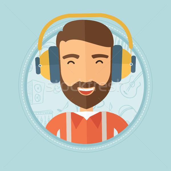 Man listening to music in headphones. Stock photo © RAStudio