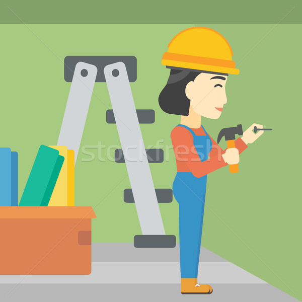 Constructor hammering nail. Stock photo © RAStudio
