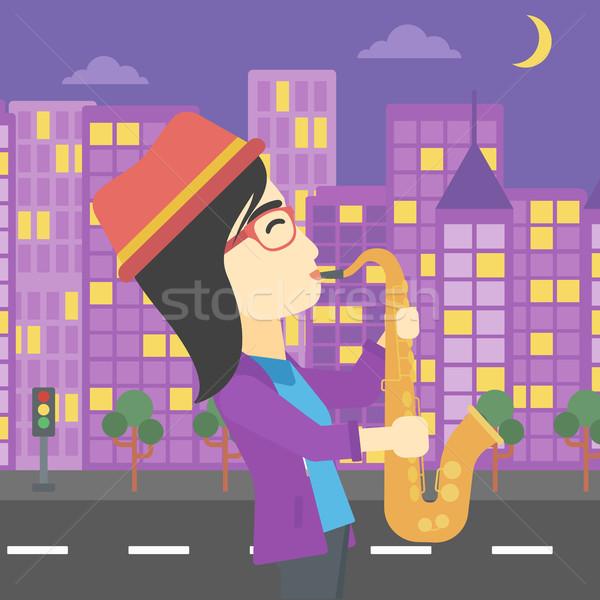 Nő játszik szaxofon ázsiai zenész éjszaka Stock fotó © RAStudio