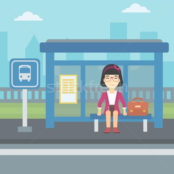 Woman waiting for bus at the bus stop. Stock photo © RAStudio
