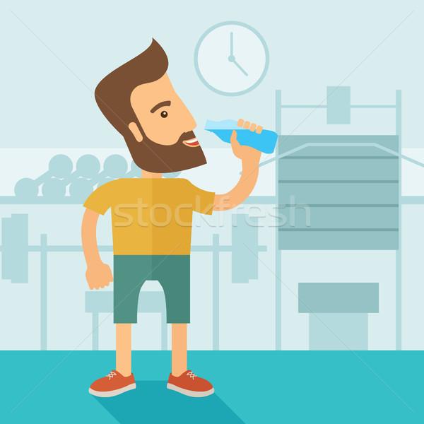 Foto stock: Cavalheiro · beber · garrafa · água · dentro · ginásio