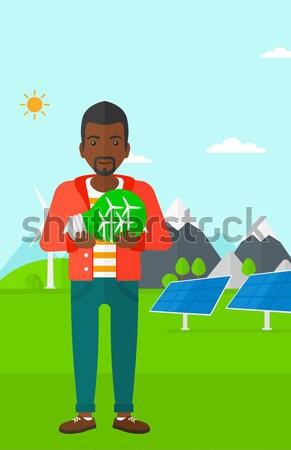 Férfi újrahasznosít tároló szemeteskuka tart újrahasznosítás Stock fotó © RAStudio