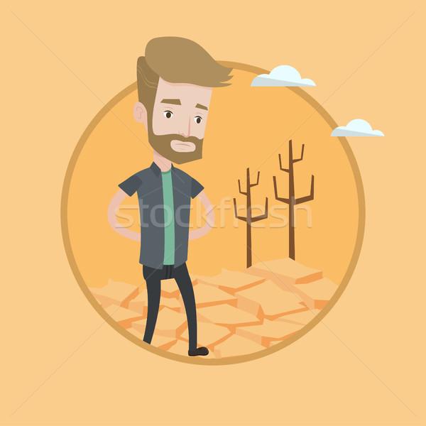 Sad man in the desert vector illustration. Stock photo © RAStudio