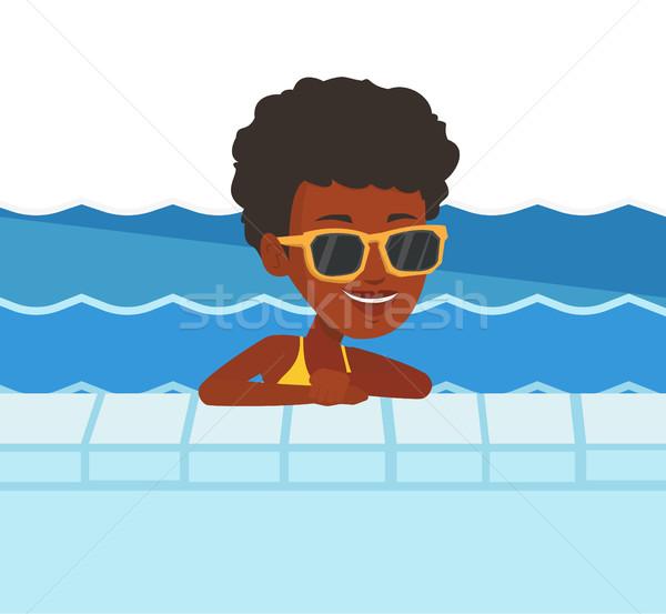 Gülen genç kadın yüzme havuzu kadın rahatlatıcı başvurmak Stok fotoğraf © RAStudio