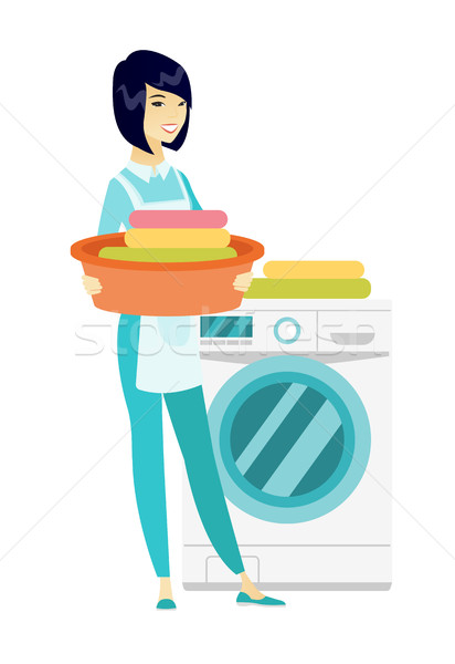 Housewife using washing machine at laundry. Stock photo © RAStudio