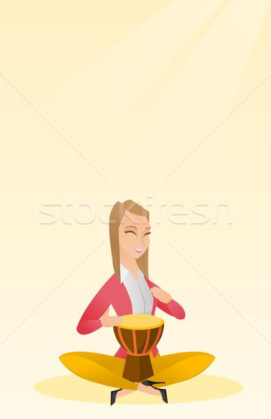 Vrouw spelen etnische trommel kaukasisch Stockfoto © RAStudio