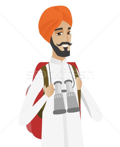 Hindu traveler man with backpack and binoculars. Stock photo © RAStudio
