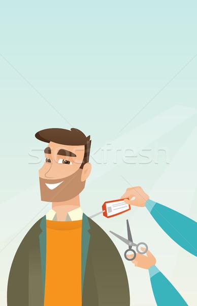 Caucasian man cutting price tag off new jacket. Stock photo © RAStudio