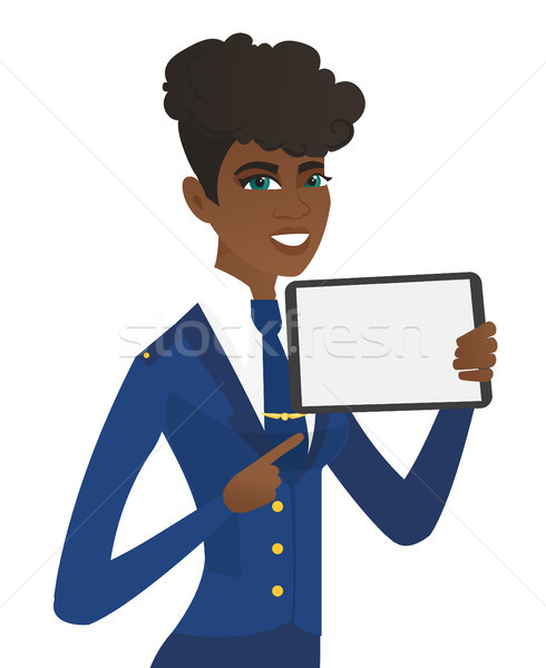 Young african stewardess holding tablet computer. Stock photo © RAStudio